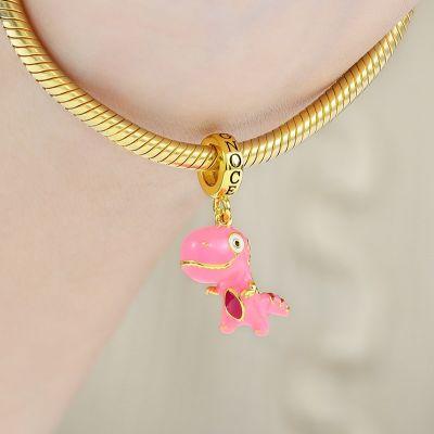 ピンクの恐竜ダングルチャーム